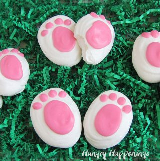 meringue bunny feet on green shredded Easter grass