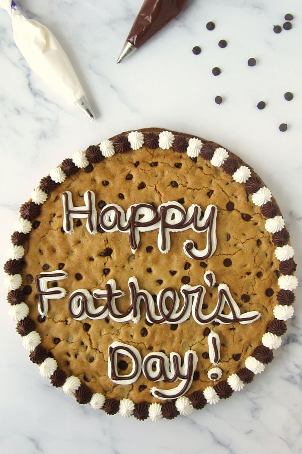 chocolate chip cookie cake decorated with chocolate and vanilla marshmallow frosting for Father's Day