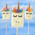 Make your unicorn themed party even more magical by serving these adorable Unicorn Rice Krispie Treats. See how to make these cute unicorn themed desserts at HungryHappenings.com. #unicorn #unicornparty #ricekrispietreats