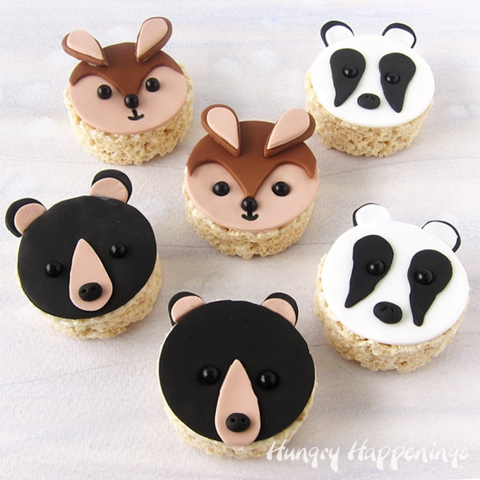 an assortment of fondant bears, bunnies, and badgers