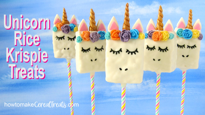 five rice crispy treat unicorn lollipops set in front of a blue sky background with text overlay