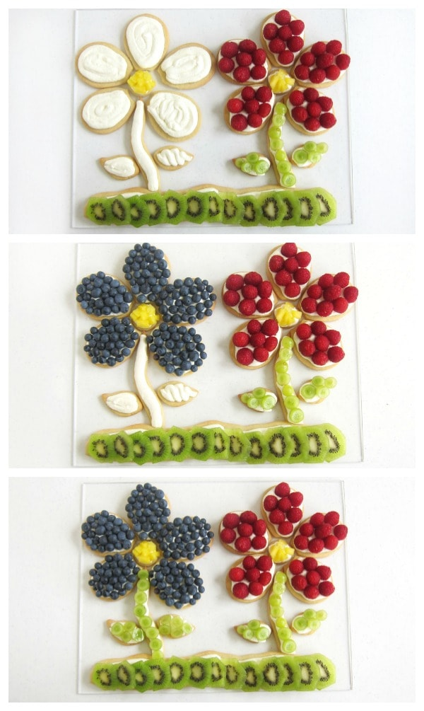 Top the fruit pizza flowers with raspberries, blueberries, green grapes, pineapple pieces and kiwi slices.