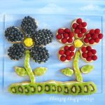 Fruit shaped fruit pizzas are made with a crispy sugar cookie, cheesecake filling, and fresh fruit.