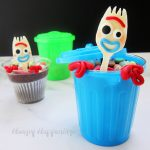 Forky Cupcakes are decorated with white chocolate forks that look like Forky and are served in plastic garbage cans.