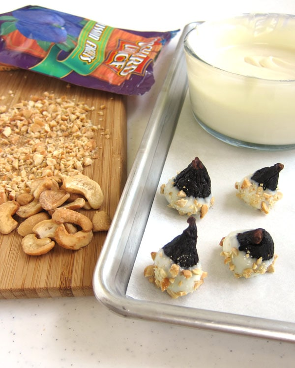 dip figs into white chocolate then sprinkle on finely chopped cashews