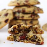 Chocolate chip cookies loaded with orange juice soaked dried cranberries and orange zest are soft and chewy and oh, so good!