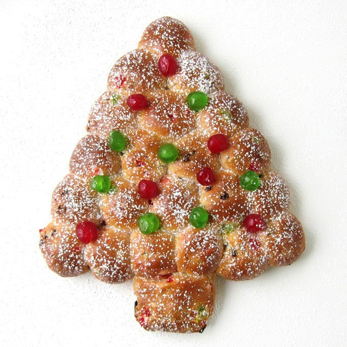 Christmas Tree Julekake decorated with red and green candied cherries.