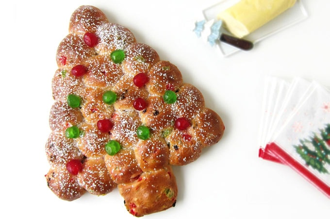 Bake a Christmas tree shaped Julekake for Christmas this year and top it with red and green candied cherries and a sprinkling of powdered sugar.