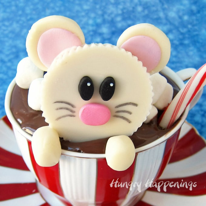 How cute is this white chocolate Reese's Peanut Butter Cup mouse, popping out of a mug of hot cocoa? The hot chocolate is actually a cupcake topped with chocolate hazelnut spread and marshmallows.