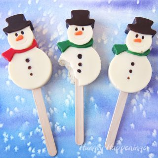Snowman Cakesicles make festive treats for Christmas.