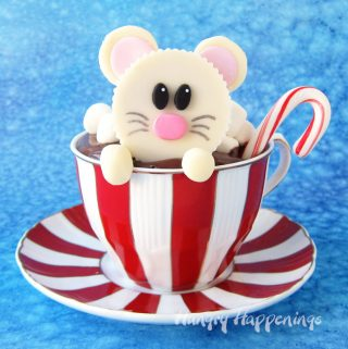 Top a hot chocolate cupcake with an adorable White Chocolate Reese's Cup Mouse then add a mini candy cane stirrer.