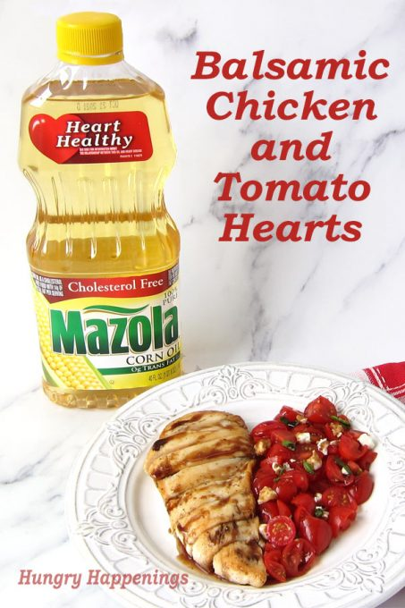 A bottle of Mazola Corn Oil sitting next to a heart-shaped chicken breast with balsamic tomatoes.
