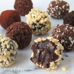 Delicious chocolate truffles coated in chopped cashews, shaved dark chocolate, cocoa powder, cookie crumbs, and a blend of dark and white chocolate shavings.