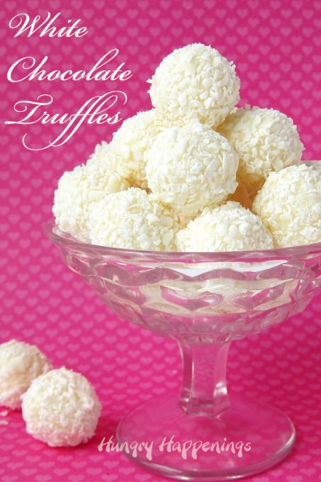 white chocolate truffles rolled in shave white chocolate in a candy dish on a pink background