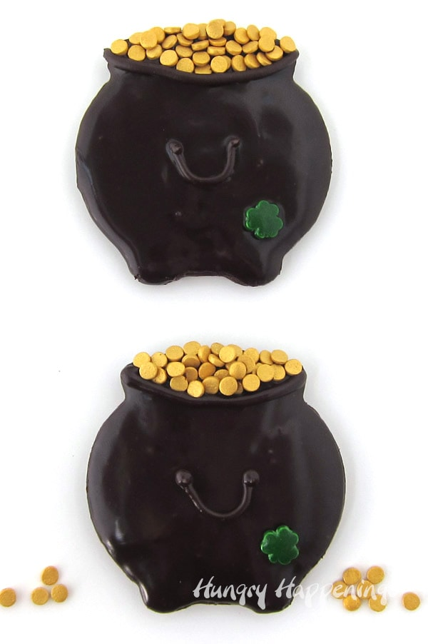 St. Patrick's Day Pot of Gold Cookies - chocolate cauldron shaped cookies glazed with chocolate ganache.