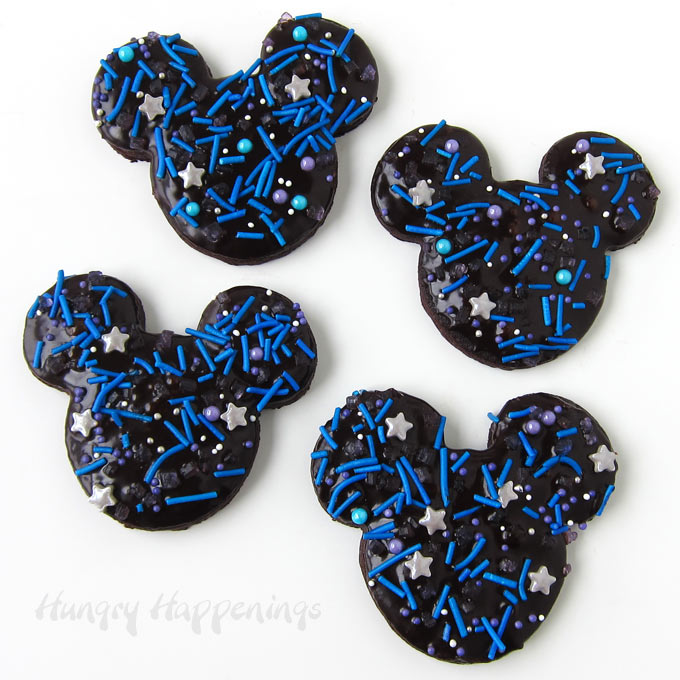 Mickey Mouse Galaxy Cookies - chocolate cookies topped with chocolate ganache and galaxy sprinkles.