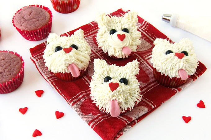 raspberry cupcakes frosted with cream cheese frosting to look like Westies