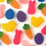 brightly colored homemade sour easter gumdrops in bunny, carrot, chick, and egg shapes