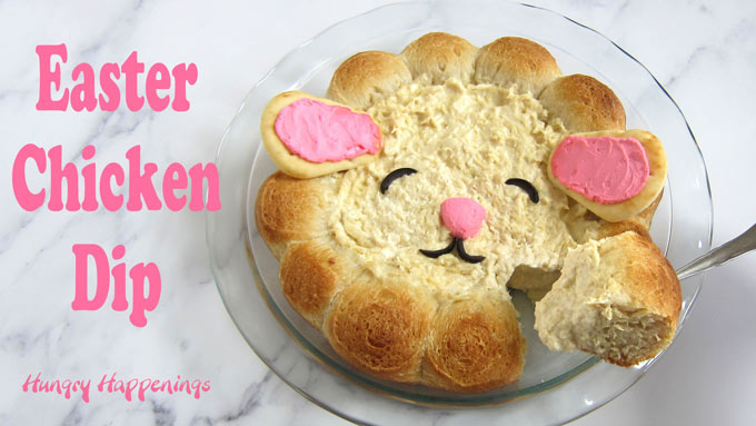 Cute lamb created out of a chicken dip with a bread roll border.