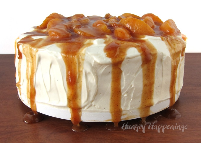 2-layer peach cake topped with cream cheese frosting and caramelized peaches.