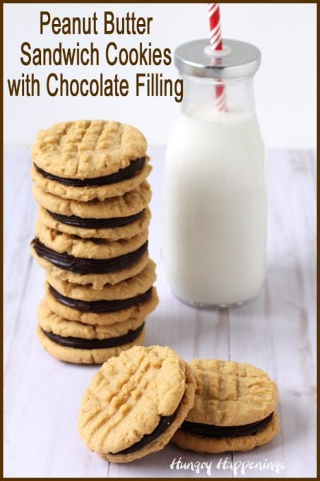 a tall stack of homemade peanut butter sandwich cookies filled with chocolate ganache set next to a bottle of milk