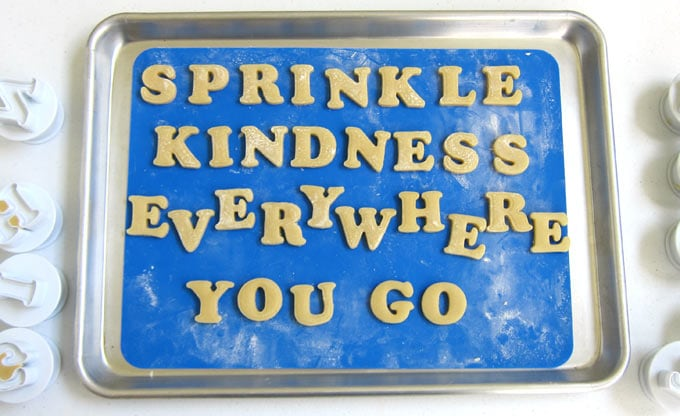 "cut-out letter cookies spell out ""sprinkle kindness everywhere you go"""