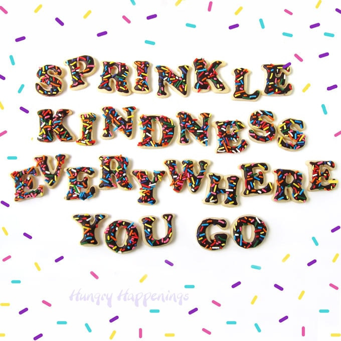 Sprinkle Kindness Everywhere You Go Cookies surrounded by colorful sprinkles.