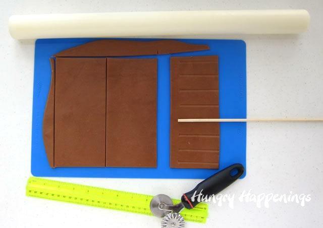 roll out the root beer modeling chocolate and cut into rectangles then use a skewer to create the root beer mug wrappers