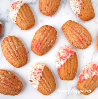 strawberry madeleines with some sprinkled with crushed freeze-dried strawberries and some dipped in white chocolate