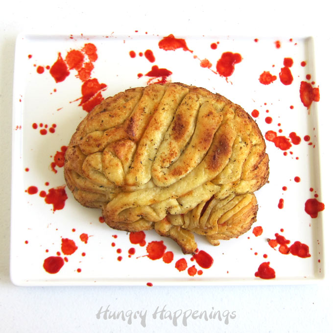 pizza brain set on a marinara sauce blood-stained platter
