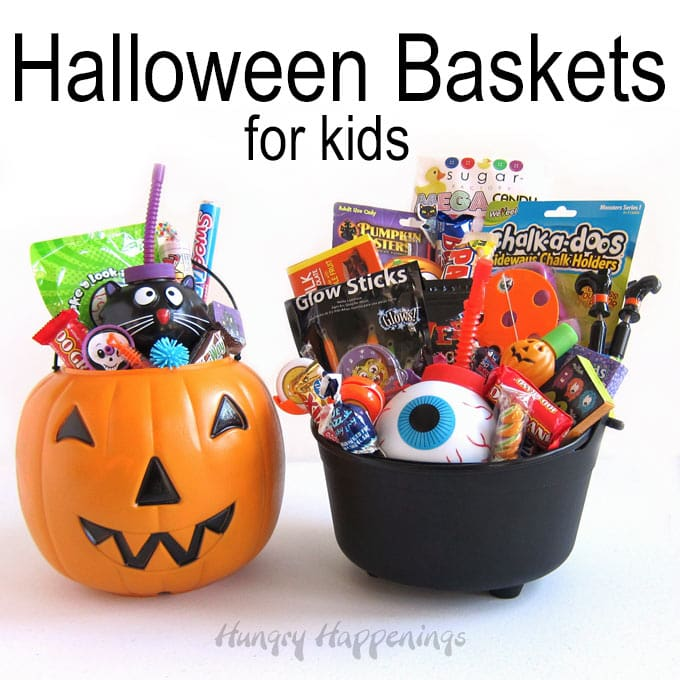 Halloween baskets filled with candy and toys. A pumpkin pail is filled with a black cat cup and lots of candy and toys. The black cauldron has a eyeball cup along with a pumpkin caring tool, glow sticks, candy bars, and toys.