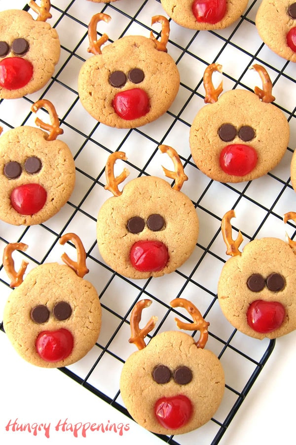 Rudolph the Red Nose Reindeer Cookies arranged on a wire cooking rack.