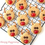 peanut butter reindeer cookies with maraschino cherry noses, pretzel antlers, and chocolate chip eyes.