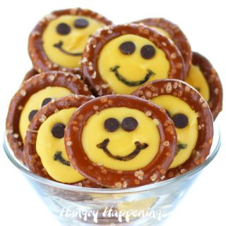 Bright yellow smiley face pretzels made using yellow candy melts or white chocolate.