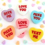 "conversation heart truffles are decorated with phrases like ""love you,"" ""miss you,"" ""text me,"" and ""bite me"" and are filled with colorful white chocolate ganache"