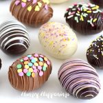 Chocolate Easter eggs decorated with a drizzle of chocolate and sprinkles.