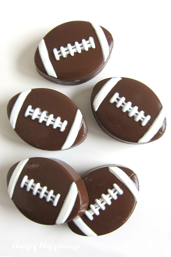 Milk chocolate footballs filled with hot cocoa mix and dehydrated marshmallows