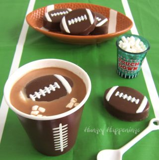 Football Hot Chocolate Bombs filled with hot cocoa mix and tiny marshmallows