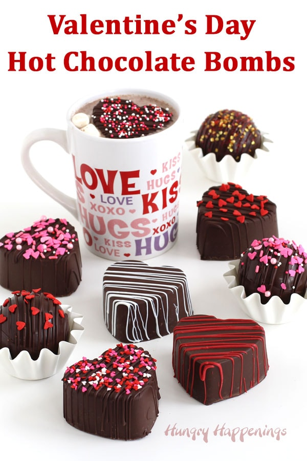 Valentine's Day Hot Chocolate Bomb hearts or spheres are decorated with red, white, and pink Valentine's Day sprinkles