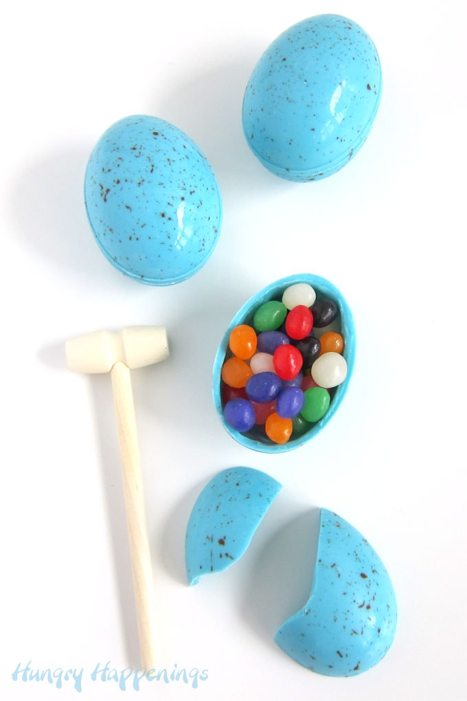 Crack open a blue speckled white chocolate robins eggs to find Easter candy inside.