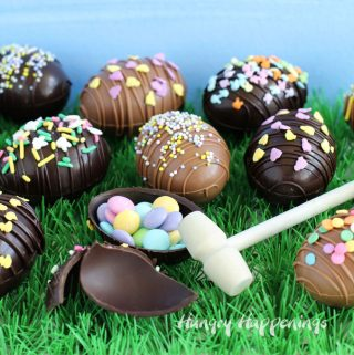 Breakable Chocolate Easter Eggs filled with Easter candy like M&M's are decorated with sprinkles.