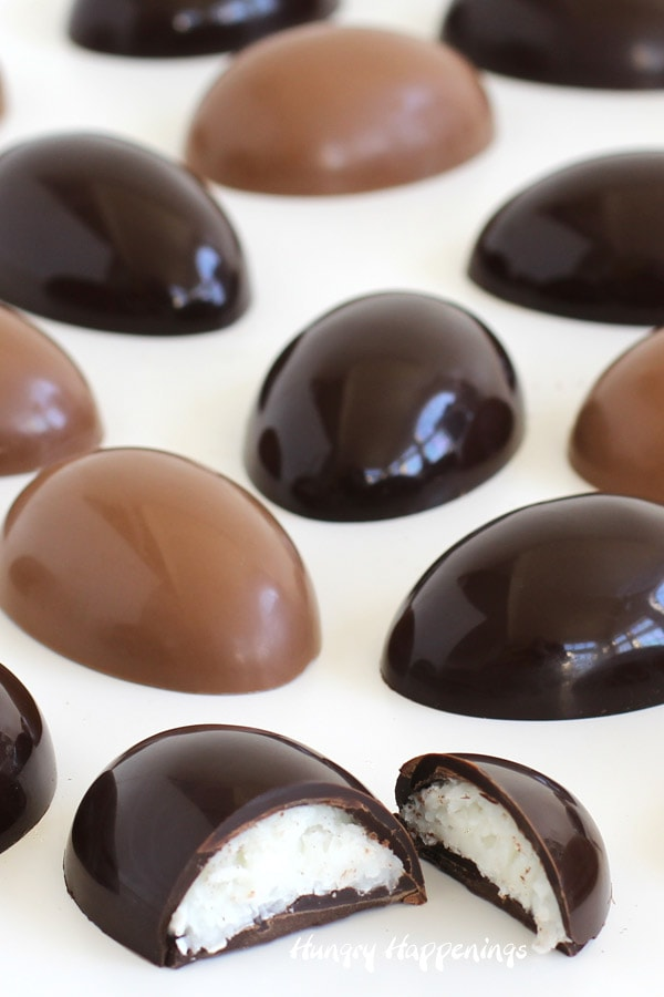 Milk and dark chocolate coconut cream eggs made using a polycarbonate egg mold look shiny and gorgeous.