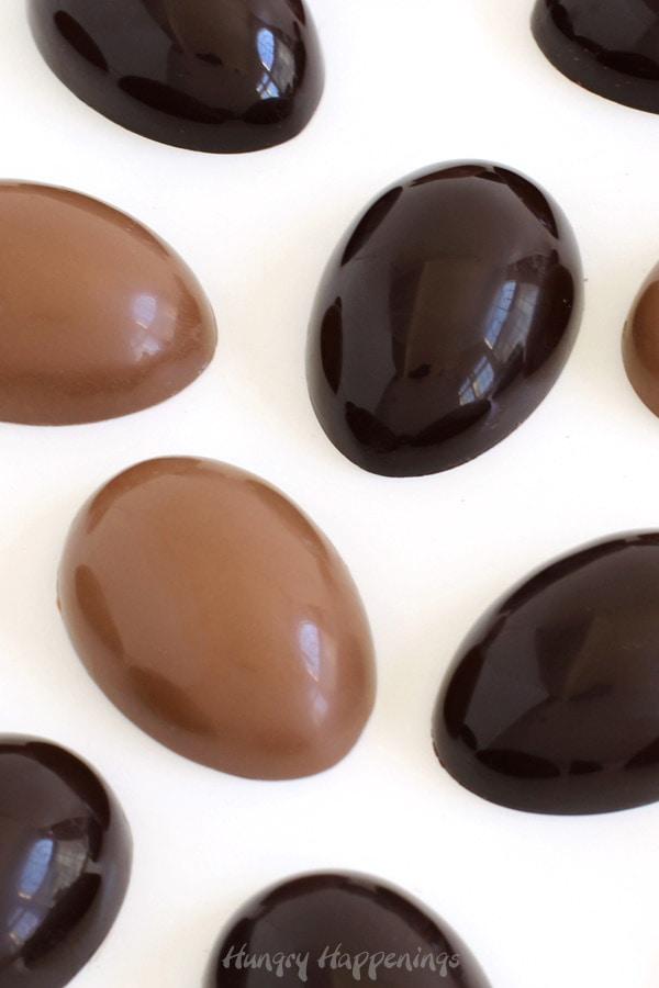 Shiny milk chocolate and dark chocolate Easter eggs made using tempered chocolate.