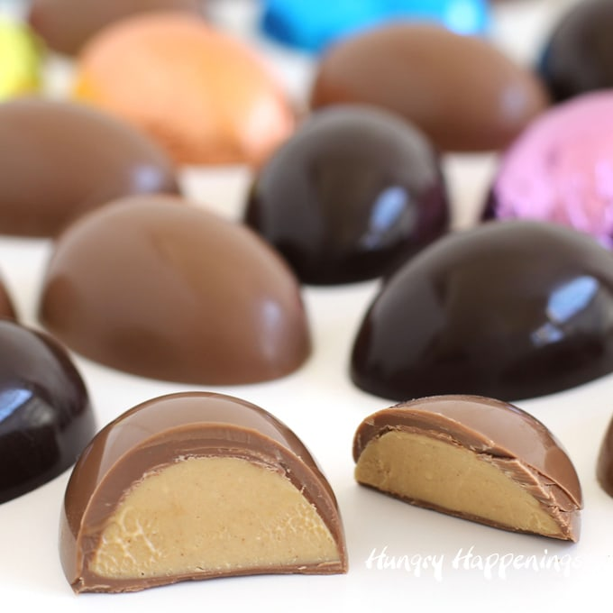 Peanut butter fudge filled chocolate eggs in milk and dark chocolate wrapped in brightly colored foil wrappers.