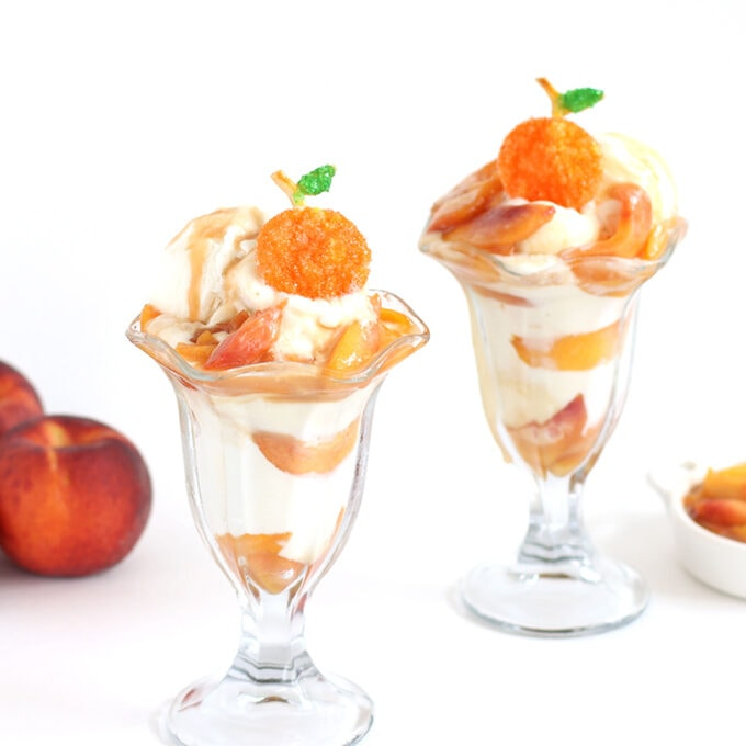 peach sundaes with vanilla ice cream topped with caramelized peaches and pie crust peaches