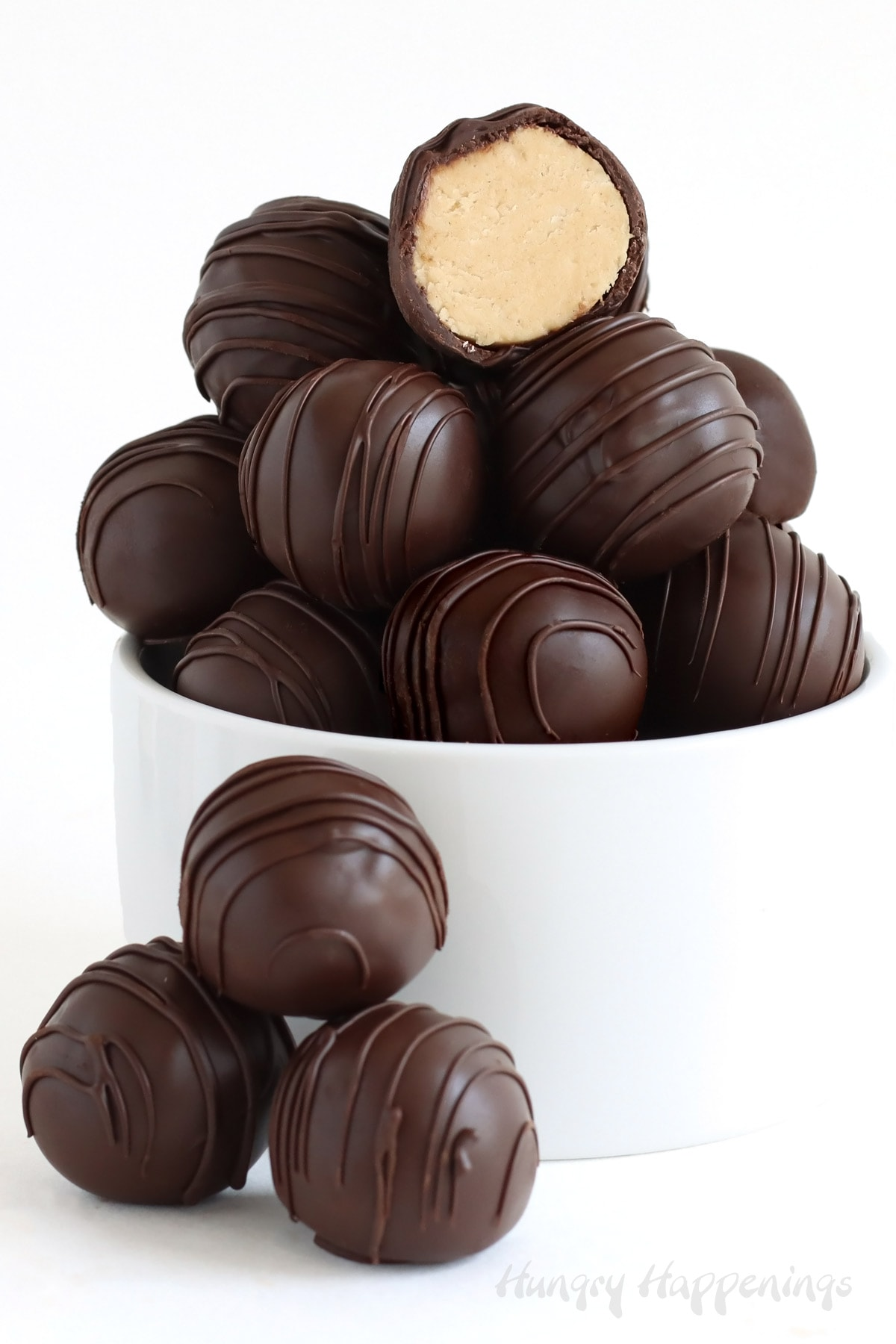 Chocolate dipped peanut butter balls drizzled with dark chocolate.