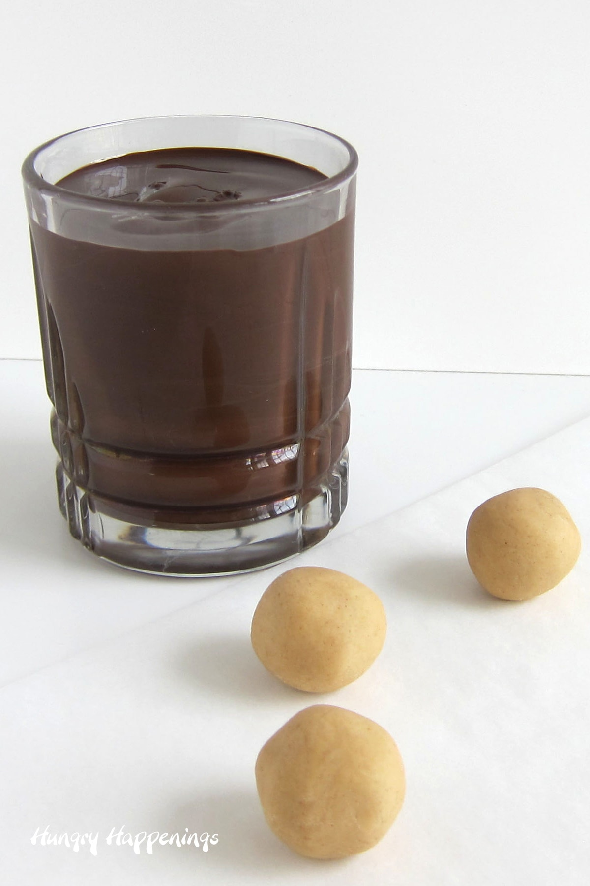 peanut butter fudge balls and melted chocolate