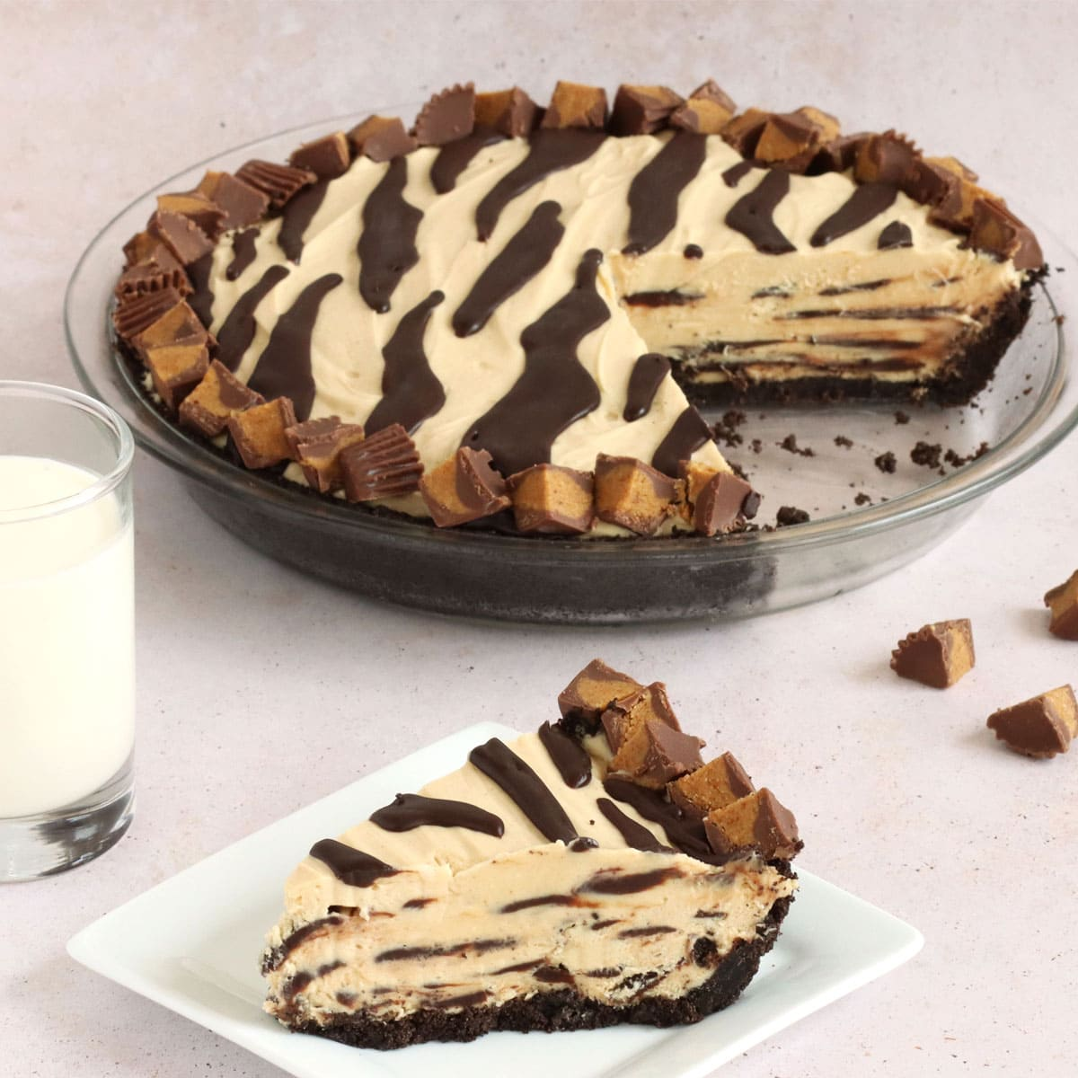 Tiger Pie - no bake peanut butter pie layered and decorated with chocolate ganache and peanut butter cups.
