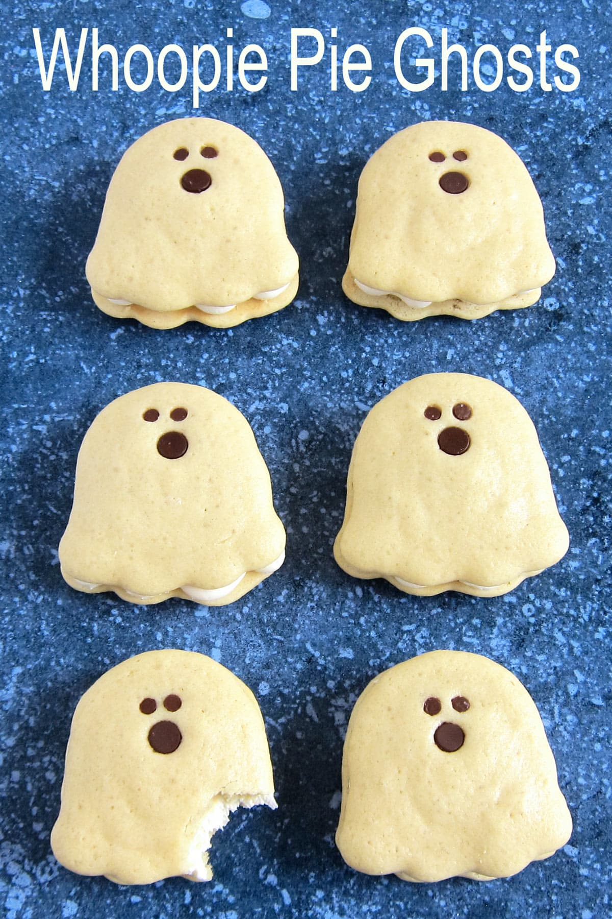 Vanilla Whoopie Pie Ghosts decorated with chocolate chips.